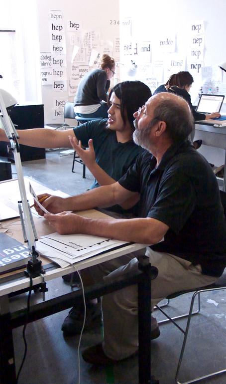 Program chair Sumner Stone (Stone Informal, Stone Sans) works with student Rolando Alcantara of Mexico.