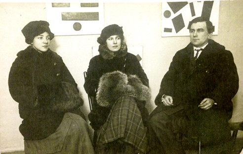 Artists Olga Rozanova (age 29), Xenia Boguslavskaya (age 23) and Kazimir Malevich (age 37) at the 0,10 exhibition.