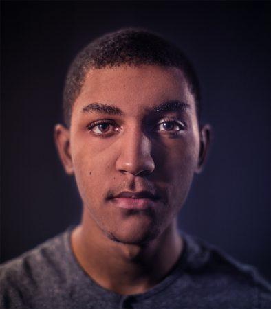 headshot of PRINT Designer of the Week Joash Berkeley, creator of typography project One in Seven Billion