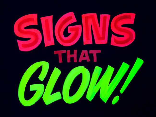 Signs that glow