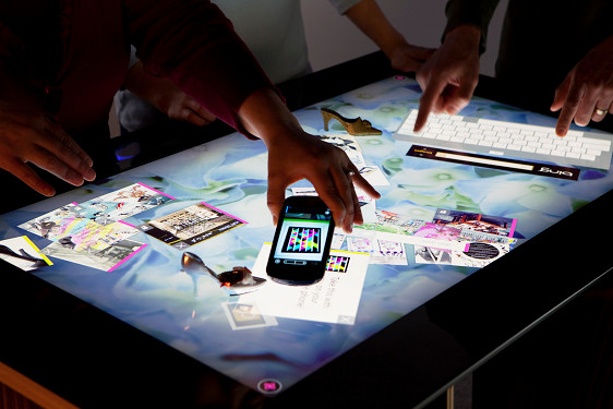 The original Microsoft Surface that debuted in 2007 was not a tablet, but a table.  image via Microsoft.com
