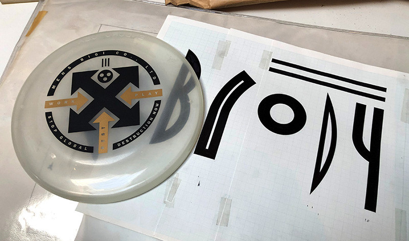 NB1 Brody type—the original artwork drawing from 1987. I was amazed to see I'd drawn it so small. Alongside this, a frisbee for Men's Bigi, the Tokyo-based fashion company.