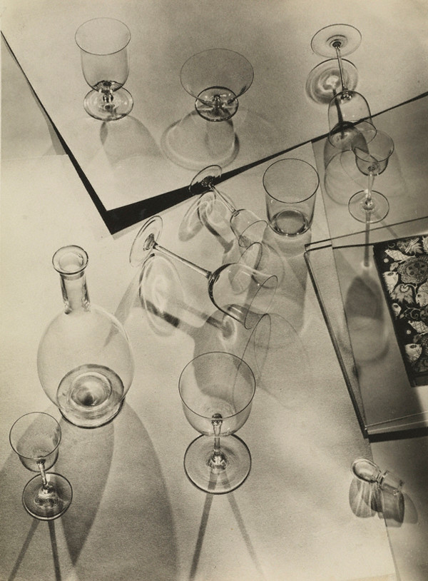 Walter Peterhans: (Composition with Nine Glasses and Decanter), 1929 - 1933. Gelatin silver print, 9 1/16 x 6 5/16 in. © Estate Walter Peterhans, Museum Folkwang, Essen. Credit: The J. Paul Getty Museum, Los Angeles.
