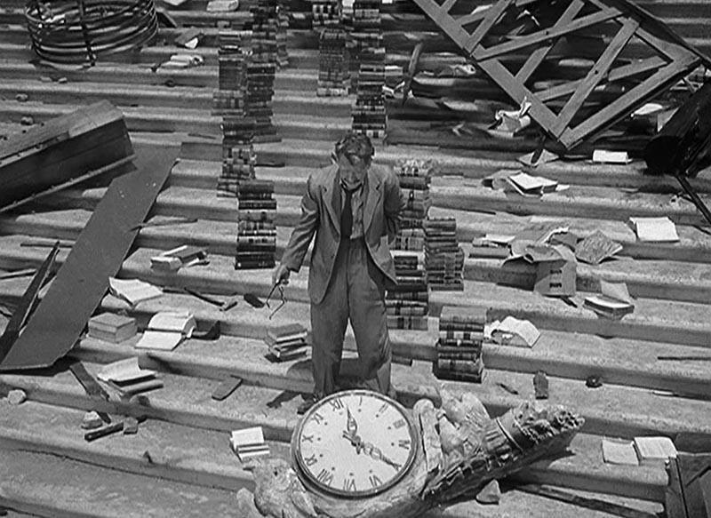 Man standing in debris