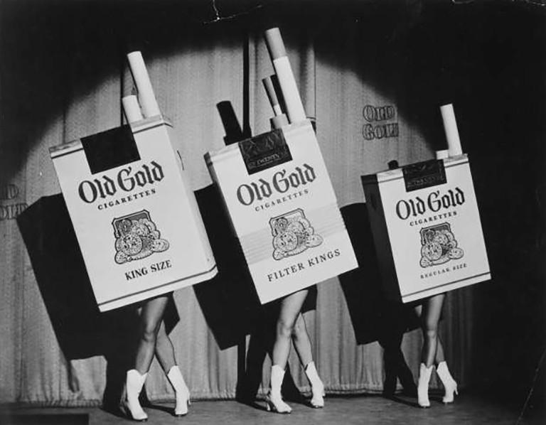 Three dancers dressed as cigarettes