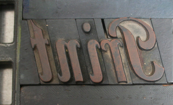 Print set in wood type and locked-up for printing