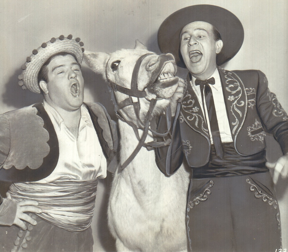 "Abbott and Costello with singing donkey in ""Rio Rita."""