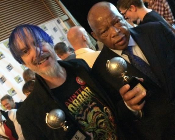 Craig Yoe and civil rights icon John Lewisholding their Eisner Awards