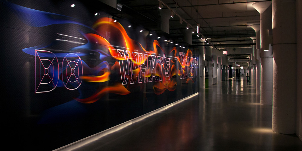 """Echo Global — Art in the Workplace: CannonDesign brought on Thirst to create large-scale murals to express the values of """"The Echo Way"""" using cues from the trucking industry. Designed in collaboration with Anna Mort, Kyle Green, Zach Minnich."""
