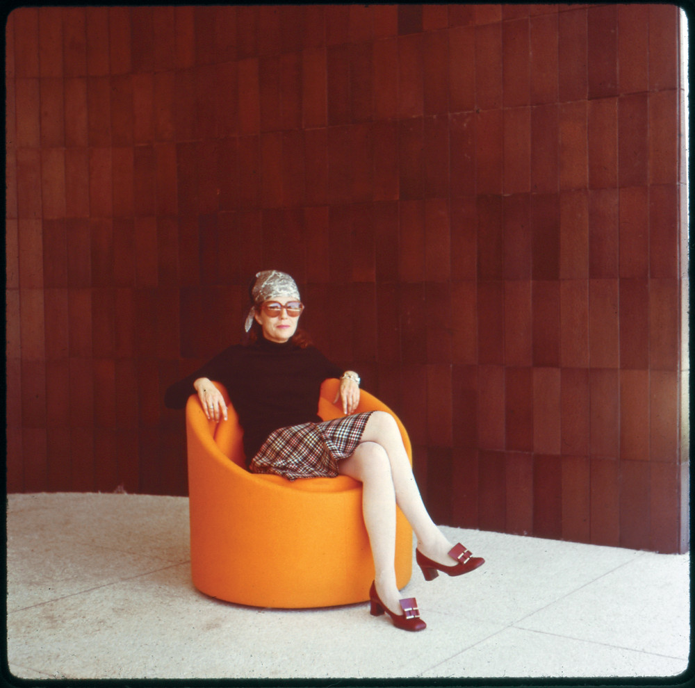 Kavanaugh is sitting pretty in this prototype chair made from a large, repurposed Sonotube upholstered in orange fabric. It was produced in the mid-1970s.