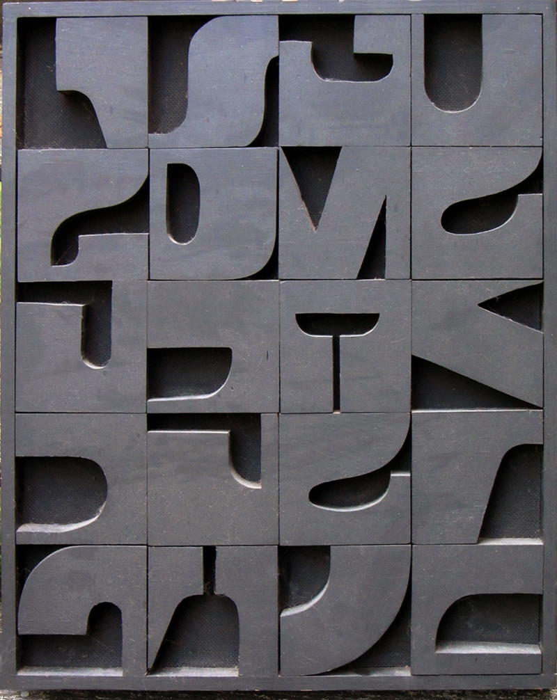 Reconstruction Eclipse. 1967. Bas-relief, black letter fragments. 21 1/8 x 17 inches.