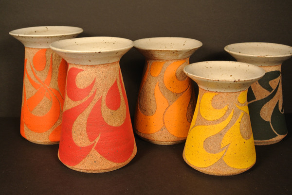 """Reem Hammad: Singing Vases (stoneware underglaze), 2014. """"These vases are a part of a series I created to celebrate spring, in color, spirit, and song. Carved out of each vase are stylized Arabic letters forming a different word that relates to music."""""""