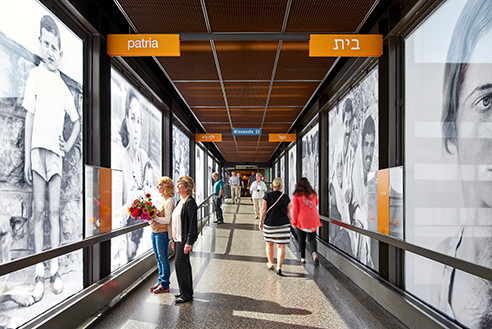 Interior view of skyway pedestrians passing by and stopping to appreciate the installation (photo:Peter Von De Linde)