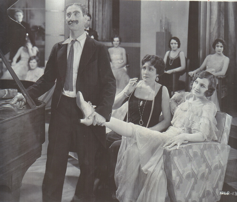 """Groucho Marx with Margaret Dumont and Lillian Roth in """"Animal Crackers."""""""