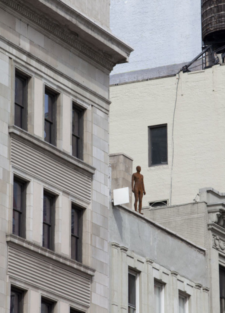 fiberglass figure on the roof of a building