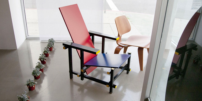 A Rietveld de Stijl chair and an Eames molded-plywood chair