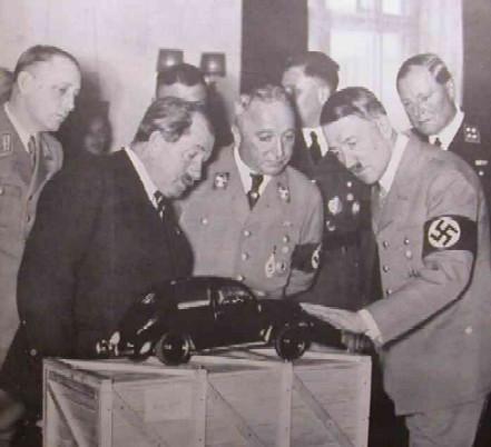 Nazis looking at a model car