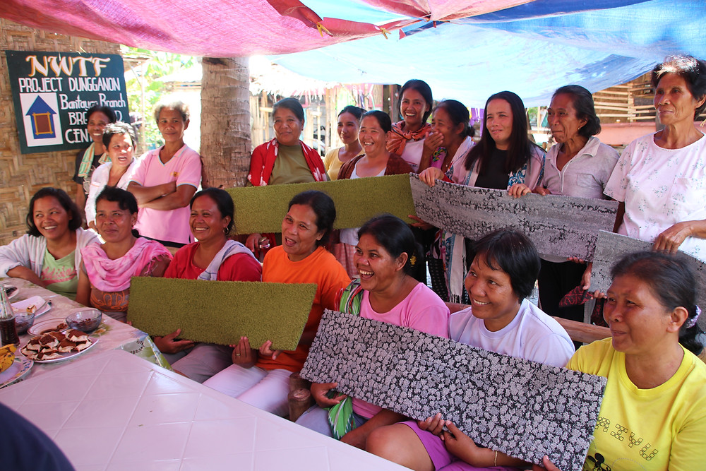 On Bantayan Island residents learn about the finished carpet tiles that will be made from fishing nets