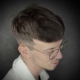Photo d'une coupe et coiffure homme tendance