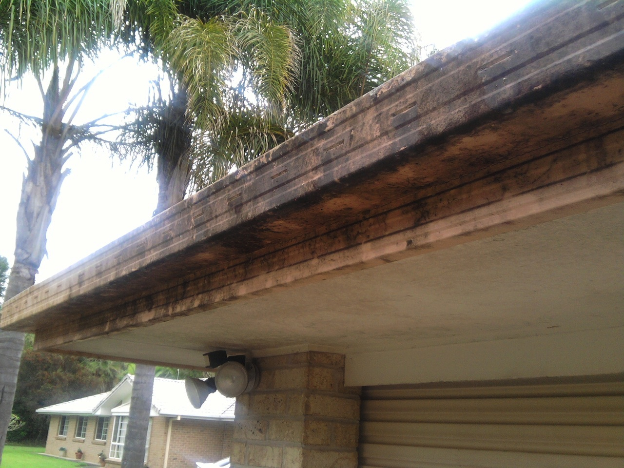Gutters before pressure cleaning