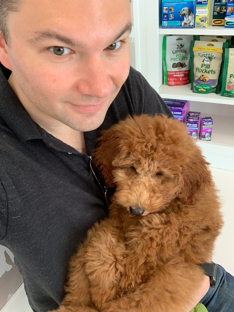 Dr. Kiefer with his labradoodle, Tuohy.