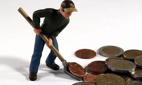 Man Shoveling Money.jpeg