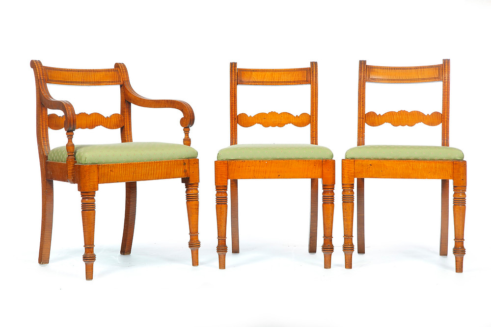 Seven Canadian Classical chairs attributed to Thomas Nisbet, St. John, New Brunswick, 1820-40, curly maple, consisting of six side chairs and one armchair, old refinish, original slip seats with later upholstery, $4500.