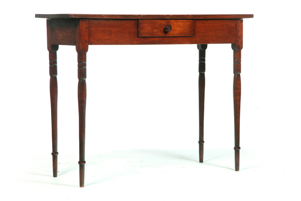 "Server, North Carolina, 1820-40, walnut with a one-board top, 37½"" high x 49"" wide, old refinish, replaced knob, flaking to the varnish, $5640."