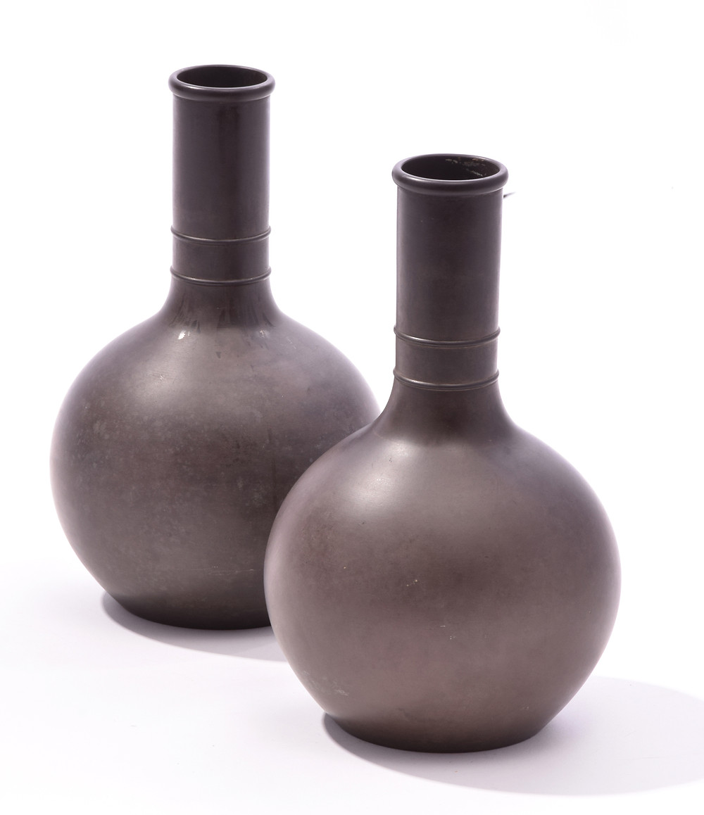 "LOT 7: PAIR OF WEDGWOOD BASALT VASES STAMPED ""WEDGWOOD TWS."" England, mid 19th century. Bottle form vases with long stout double banded neck conforming to globular reservoir. Impressed stamps to underside of both - Wedgwood, V, and TWS. Estimate $ 700-900 Selkirkauctions.com"