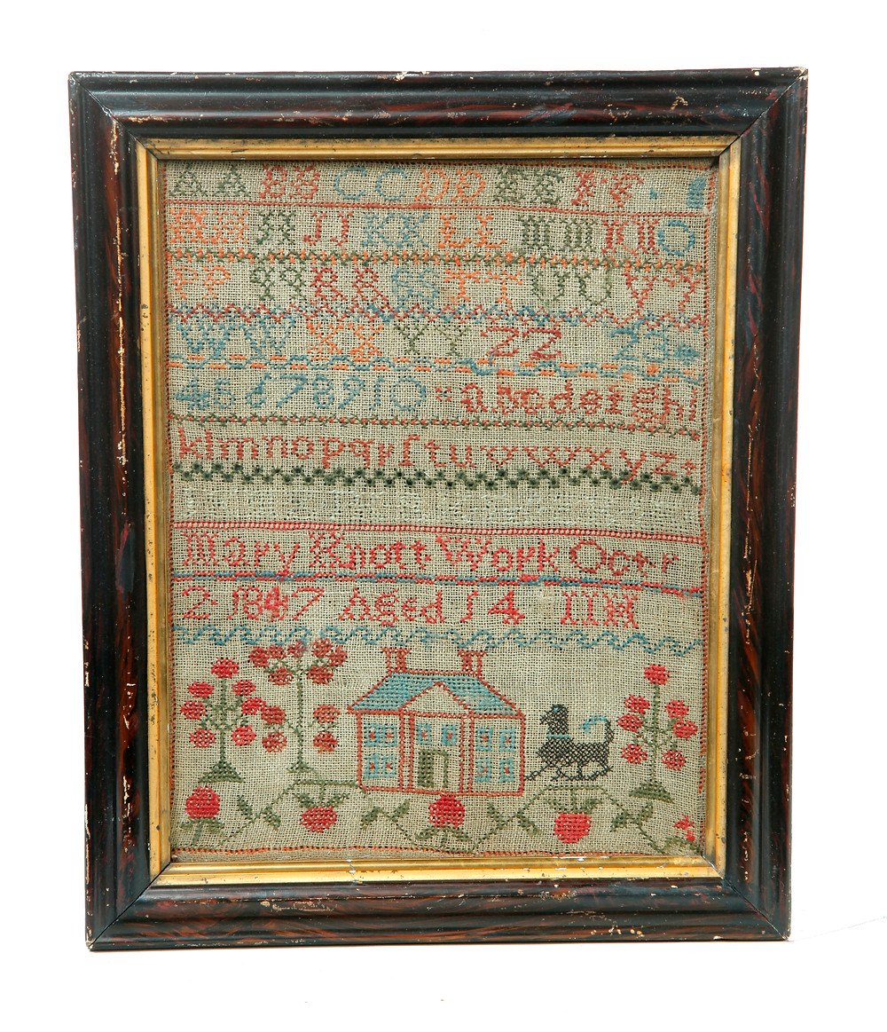 "Ohio sampler dated 1847, the work of 14-year-old Mary Knott, born in Coshocton County, wool on linen, alphabets above a house and dog, grain-decorated frame, 14½"" x 11½"", $3360."