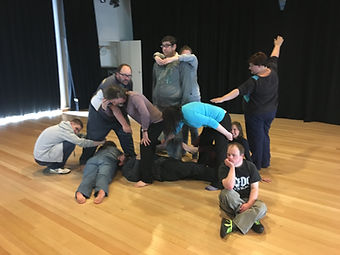 Acting students creating an image with their bodies.