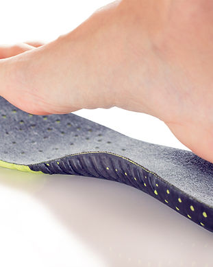 orthopedic insole and female leg above i