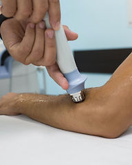 Procedure shock wave therapy at clinic.