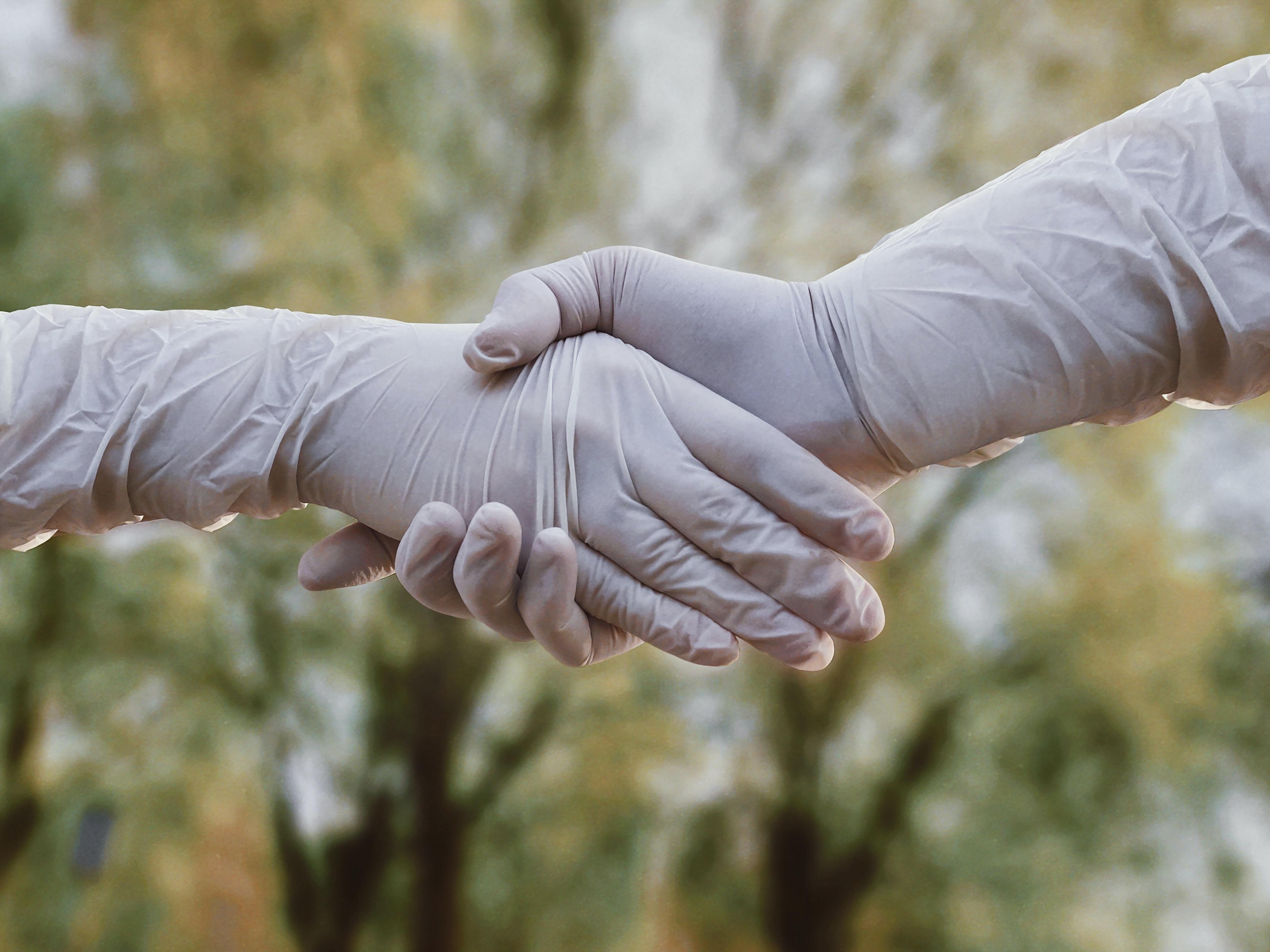"img alt"" Covid-19 handshake, gloves, stay safe, prevent transmission"""