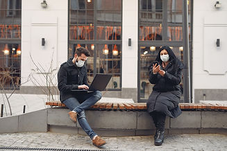 young-couple-wearing-medical-masks-with-