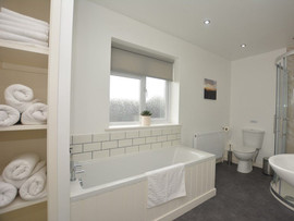Large bathroom with luxury towels