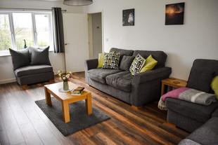 Large living room with log burner