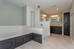 Primary Bathroom with Iron Ore cabinets
