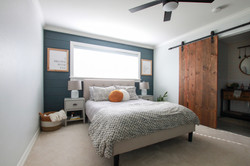 Shiplap accent wall with barn door