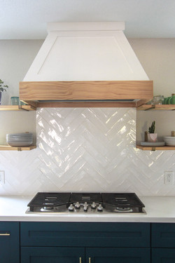 Shelves next to vent hood with wood detail
