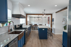 Farmhouse Kitchen with Navy Blue Cabinets & Wood Beams