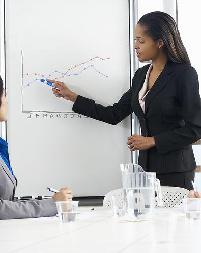 Businesswoman Giving Presentation To Fem