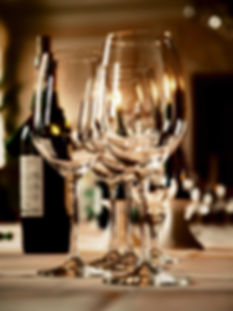 wine glasses and a bottle on a table.jpg