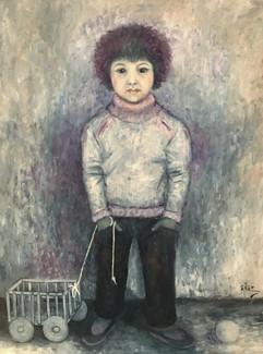 Niño con carrito. 1970