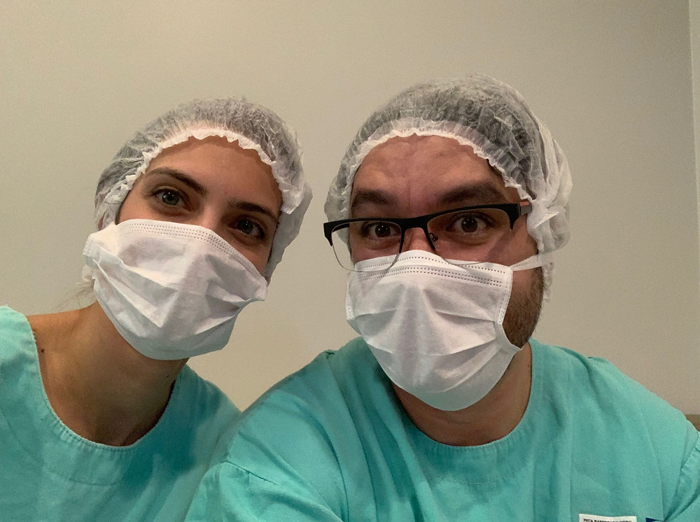 Doula and partner during c-section
