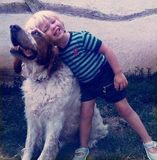 a child and a dog