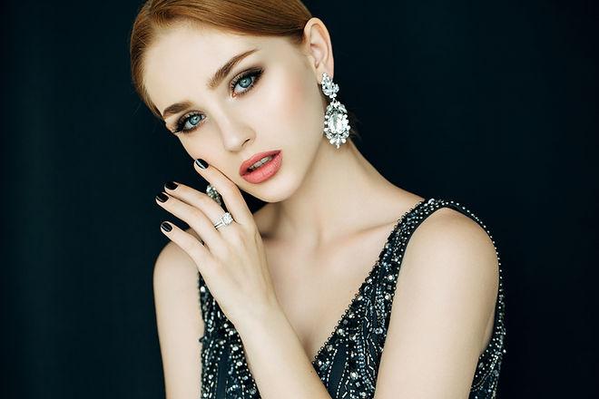 woman wearing large earrings
