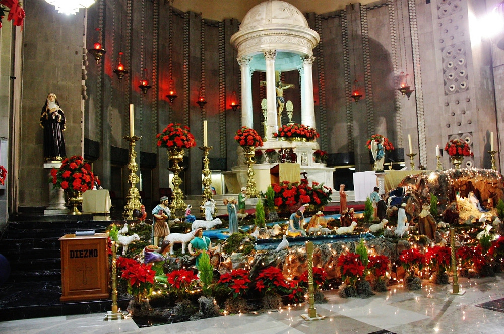 "Modern church in Mexico, decorated with ""Los Flores de Nochebuena."""
