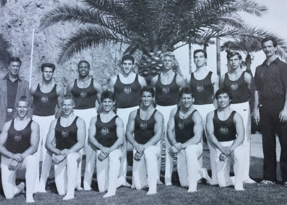 Members of ASU Men's gymnastics team standing in front of  a palm tree in Tempe, AZ
