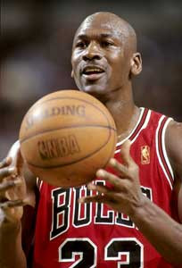 michael jordan wearing bulls jersey with scalding basketball floating  above both hands